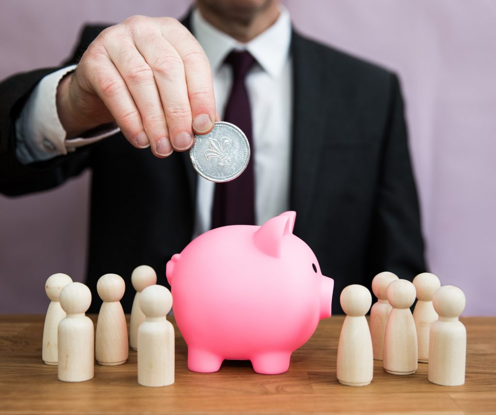 An employer paying money into a workplace or private pension scheme piggybank