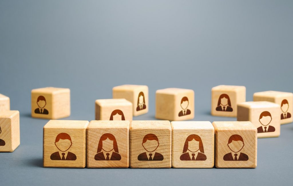 Line of blocks with employees. Building a business team from many candidates. Personnel management,